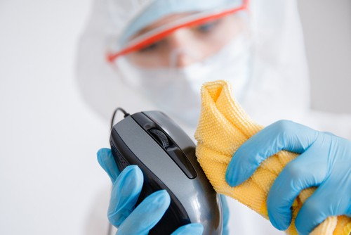 Sanitizing office computer mouse